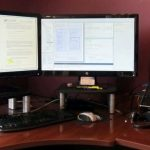 Desk of a nerd with 2 monitors and stands